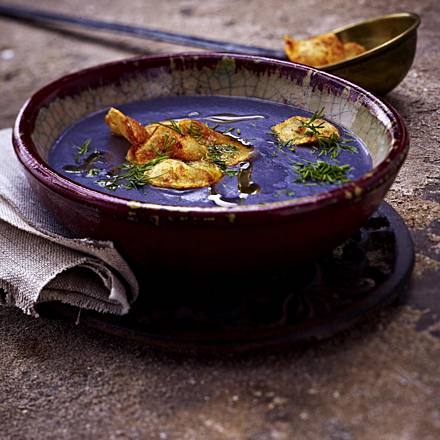 Blue potato soup with dill and potato chips