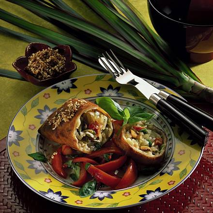 Spring roll on basil and tomato salad