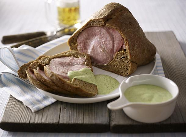 Ham in bread dough with green sauce