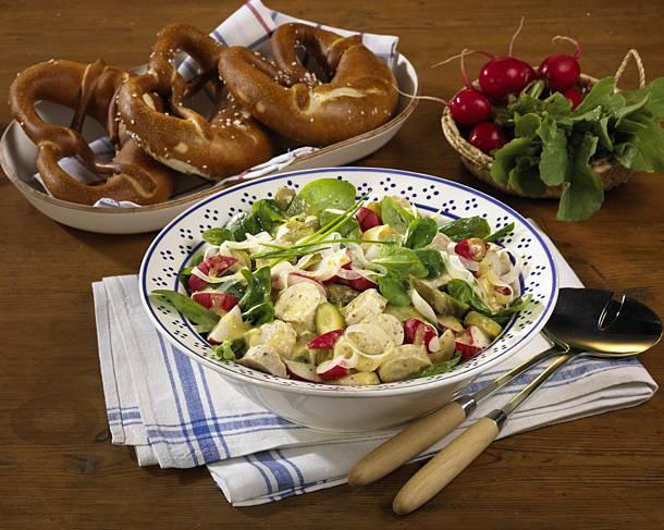 White sausage and radish salad with pretzels
