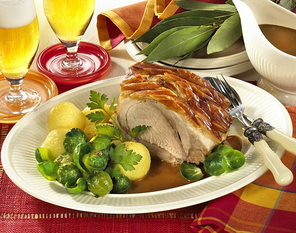 Roast pork with Brussels sprouts and dumplings