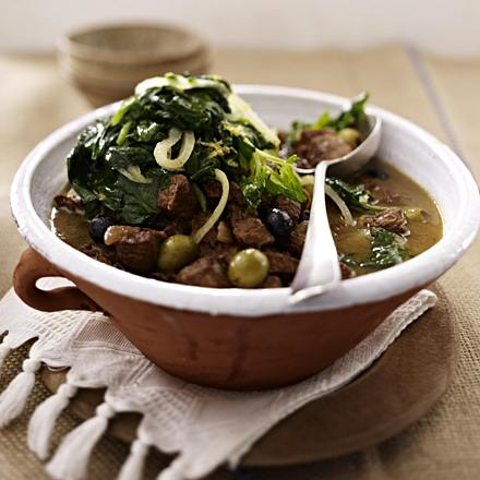 Lamb goulash with olives and chorta (spinach vegetables)
