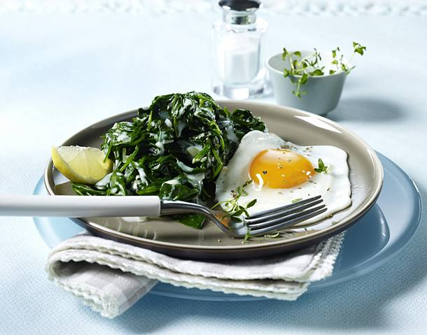 Spinach vegetables with fried egg