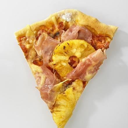 Pizza with pineapple, ham and tomato crème fraîche