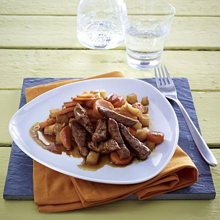 Sliced beef with roasted carrot and radish vegetables