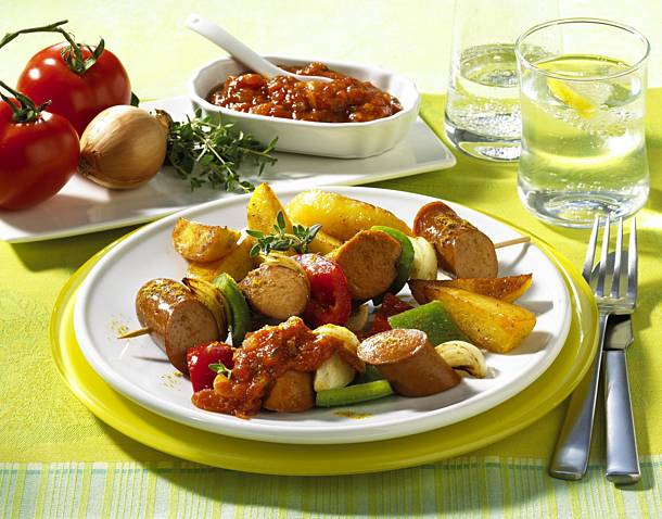 Currywurst skewer with potato wedges