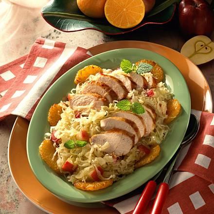 Chicken fillet on apple and sauerkraut